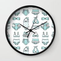 suits Wall Clocks featuring Bathing suits by Kay Wolfersperger