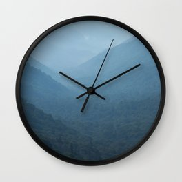 Morning mountains going into the distance Wall Clock
