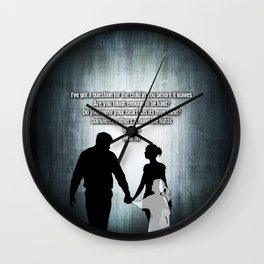 u2's there is a light Wall Clock