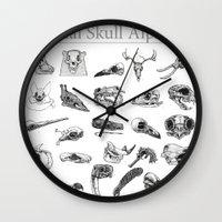 animal skull Wall Clocks featuring Animal Skull Alphabet by Stephan Brusche