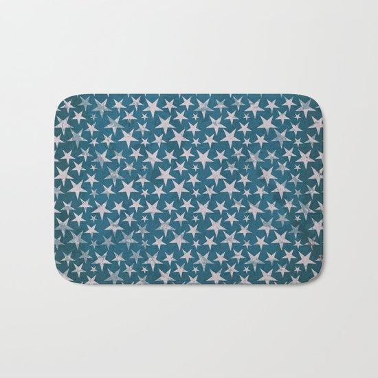 White stars on grunge textured blue background Bath Mat