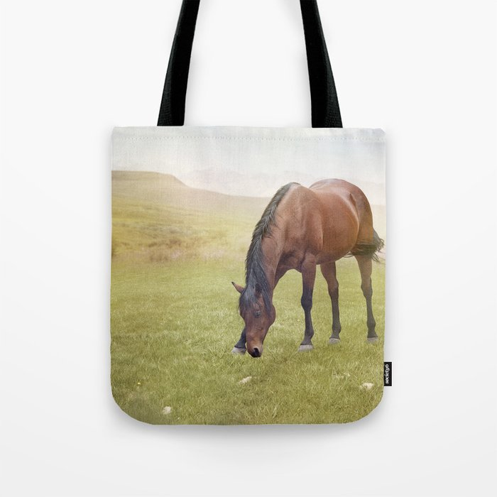 Brown  horse grazing in summer valley Tote Bag