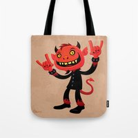heavy metal Tote Bags featuring Heavy Metal Devil by John Schwegel