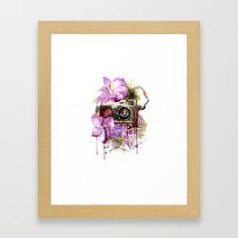Camera in flowers Framed Art Print
