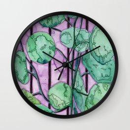 Leafy Plant on Purple Background Wall Clock