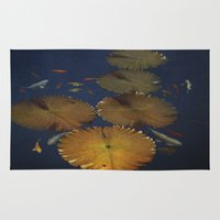 amy pond Area & Throw Rugs featuring Koi Pond by TaLins