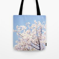 cherry blossoms Tote Bags featuring Cherry Blossoms by myhideaway