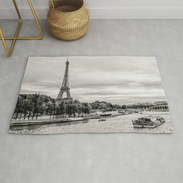 Eiffel Tower and boats on Seine river in Paris, France Rug