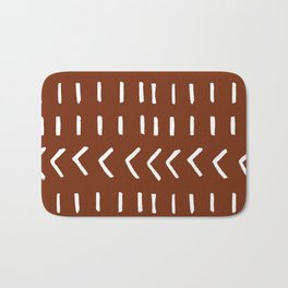 White Lines and Arrows on Rust Bath Mat