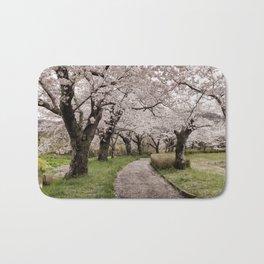 Row of cherry blossom trees Bath Mat