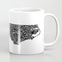 north carolina Mugs featuring Typographic North Carolina by CAPow!