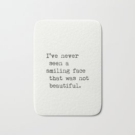 I've never seen a smiling face that was not beautiful. Bath Mat
