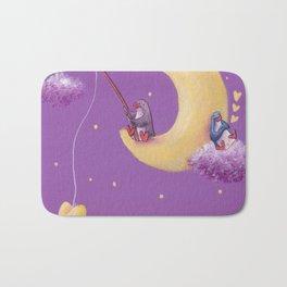 Purple penguin fishing on moon while blue penguin dreams Bath Mat