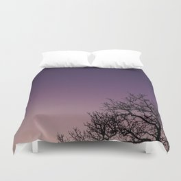 A bare tree in the sunset. Duvet Cover