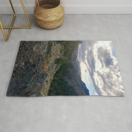 Light through clouds - A mountains scene Rug