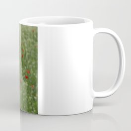 Seed Head With A Beautiful Blur of Poppies Background Coffee Mug