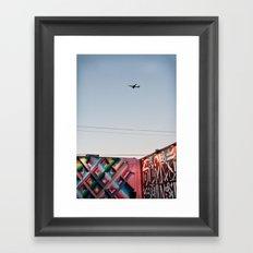 Plane in night sky Framed Art Print