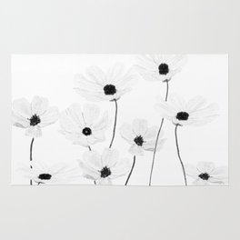 black and white cosmos Rug