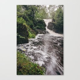 Waterfall and swirling river. Near Ullswater, Cumbria, UK. Canvas Print