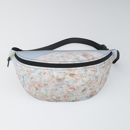 Granite pebble with blue water background Fanny Pack