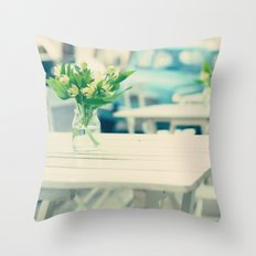 Flowers on the table (Streetside cafe table) Throw Pillow