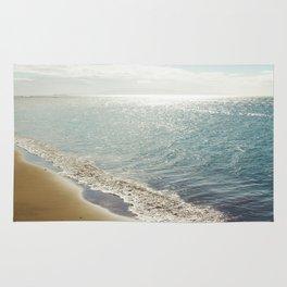 beauty and the beach Rug