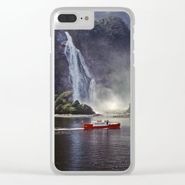 Boat cruising in Milford sound Clear iPhone Case