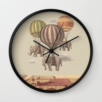 clouds Wall Clocks featuring Flight of the Elephants  by Terry Fan