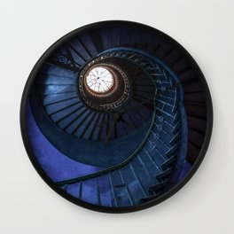 Abandoned blue spiral staircase Wall Clock