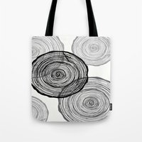 tree rings Tote Bags featuring rings by Claire Rose Kleese