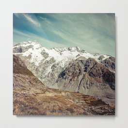 Snow-Capped Mountains Under Wispy White Clouds Metal Print