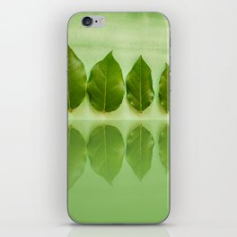 Five leaves with reflections in water close front view iPhone Skin