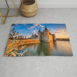 Castle Sully sur Loire at sunset, Loire valley, France Rug