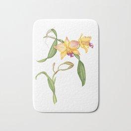 Flowering yellow cattleya orchid plant Bath Mat