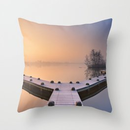 Jetty on a still lake on a foggy winter's morning Throw Pillow