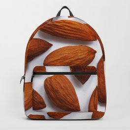 pattern from almonds seeds on a white background Backpack