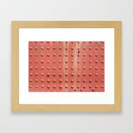Riveted metal wall surface Framed Art Print