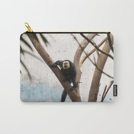 Black Monkey on sky-blue wall. Carry-All Pouch