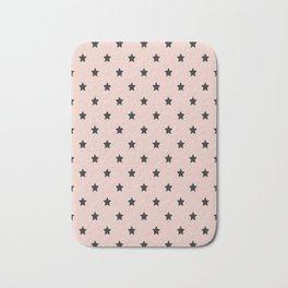 Black stars pattern on pastel pink background Bath Mat