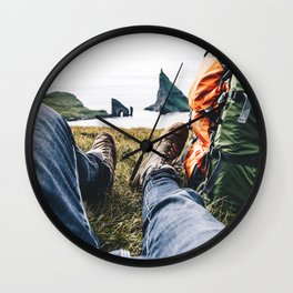 backpacker resting at faroe Wall Clock