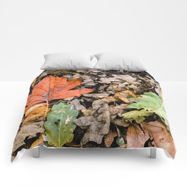 Autumnal leaves on the ground Comforters
