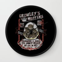 crowley Wall Clocks featuring Crowley 's Muffins  - Supernatural by KanaHyde