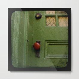 The Red Doorknob Metal Print