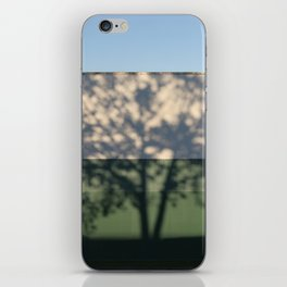 Shadow Tree on an industrial building iPhone Skin