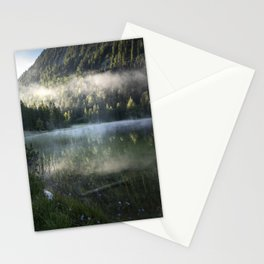 Fog cloud over lake, Flowers in Front. Amazing shot of the Ferchensee lake in Bavaria, Germany. Scenic foggy morning scenery at sunrise with mountain in the back. Stationery Cards