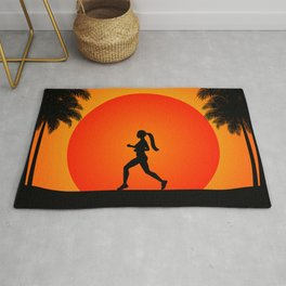 Running woman in the beach Rug