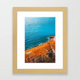 orange rooftops and blue ocean Framed Art Print