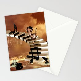 Cute little girl dancing on a piano Stationery Cards
