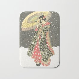 In the snow with an umbrella Bath Mat