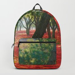Red Resurrection Lilies in full bloom in the forest Backpack